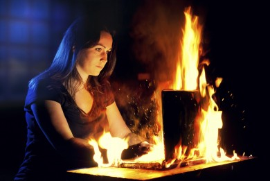 Woman uses a burning laptop