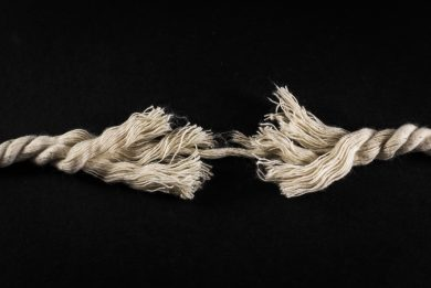 Frayed Rope and Thread on Black Background